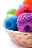 Yarns for knitting on a white background in the basket — Stock fotografie