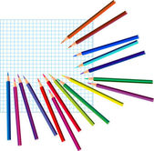 Colored pencils on a squared paper — Stock Vector