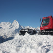 Stock Photo: Snowcat on mountains