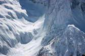 Para-glider flight over the mountains in winter — Stock Photo