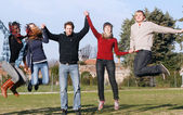 Multiracial kids jumping happily at the park — Stock Photo