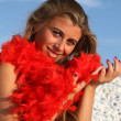 Stock Photo: Beautiful girl with red feather boa