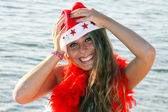 Girl christmas on the beach — Stock Photo