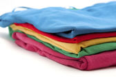 Pile of colorful T-shirts — Stock Photo