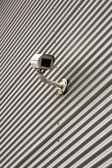 Security camera on a building — Stock Photo