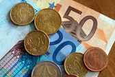 Euro banknotes with coins — Stock Photo