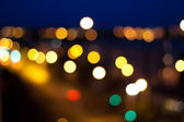 Blurred colorful circles bokeh of christmas lights — Stock Photo