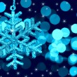 Christmas decoration snowflake on defocused lights and stars ba — Stock Photo #12459471