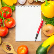 Organic Vegetables on Wooden Table and Notebook - Foto Stock