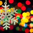 Christmas decoration snowflake  on defocused lights background — Stok fotoğraf