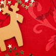 Red Christmas Background with Handmade Reindeer, Golden Stars an — Stock Photo