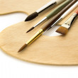Art brushes on wooden palette isolated — Stock Photo #40001009