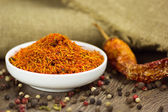 Saffron in saucer with pepper and chili — Stock Photo