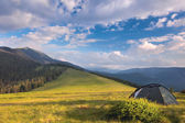 Camping tent in the mountains. Summer, blue sky, clouds and high — Stock Photo
