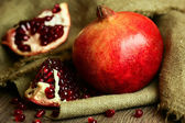Ripe pomegranate with red seeds  — Stock Photo