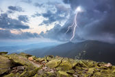 Thunderstorm with lightening and dramatic clouds in mountains — Stock Photo