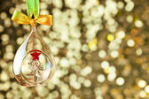 Christmas magic golden background with glass bauble and colorful — Stock Photo