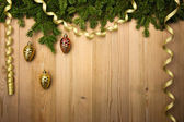 Christmas Wooden Background with fir tree, golden ribbon and dec — Stock Photo