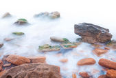 Shore of the sea, rocks and flowing water - white background — Stock Photo