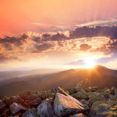 Sunset in the mountains landscape. Dramatic sky,  colorful stone — Foto Stock