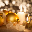 Golden Christmas background with candles, baubles and ribbons  — Stock Photo #51267659