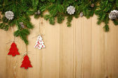Christmas background with firtree, decorative trees and cones on — Stock Photo