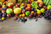 Big assortment of Fresh Organic Fruits, frame composition on woo — Foto de Stock