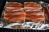 Grilling salmon — Stock Photo
