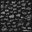 Page of white grunge graffiti tags on black — Stock Photo