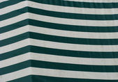 Striped sail cover for market place stand in green — Stock Photo