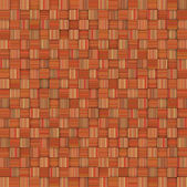 Mosaic tiled orange yellow striped checker backdrop — Stock Photo