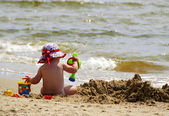 Baby on beach — Stock Photo