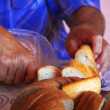 Man cutting bread — Stock Photo