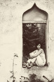 Girl or woman, window, antique — Stockfoto