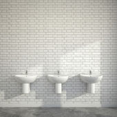 WC room with three wash basins at empty wall of bricks — Stock Photo