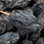 Raisins black many macro — Stock Photo #44033069
