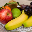 Plate of colorful fruits — Stock Photo