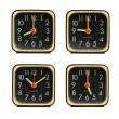 Stock Photo: Small clocks showing various time of day