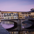 Sunset view of ponte vecchio in florence, italy - Stock Photo