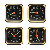 Small clocks showing various time of the day — Stock Photo