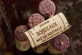 Bordeaux red wine bottle corks — Stock Photo
