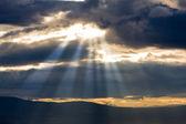 Sunshine through clouds — Stock Photo