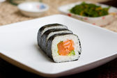 Plate of fresh salmon japanese sushi — Stock Photo