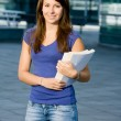 Pretty caucasian girl standing in school — Stock Photo