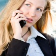 Blonde business woman on mobile phone — Stock Photo