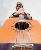 Man playing acoutic guitar — Stock Photo