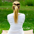 Blonde girl in park doing yoga — Stock Photo