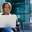 Stock Photo: Africamericbusiness womwith computer