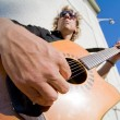 Man playing acoutic guitar - Stock Photo
