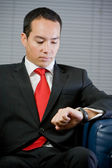 Handsome business man looking at his watch — Stock Photo